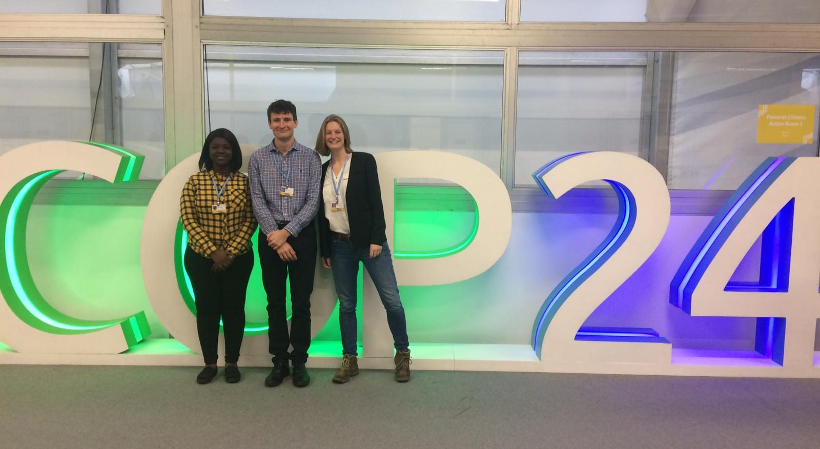 COP24 - some of the Grantham Scholars posing in front of the massive COP logo: what's it like at COP?