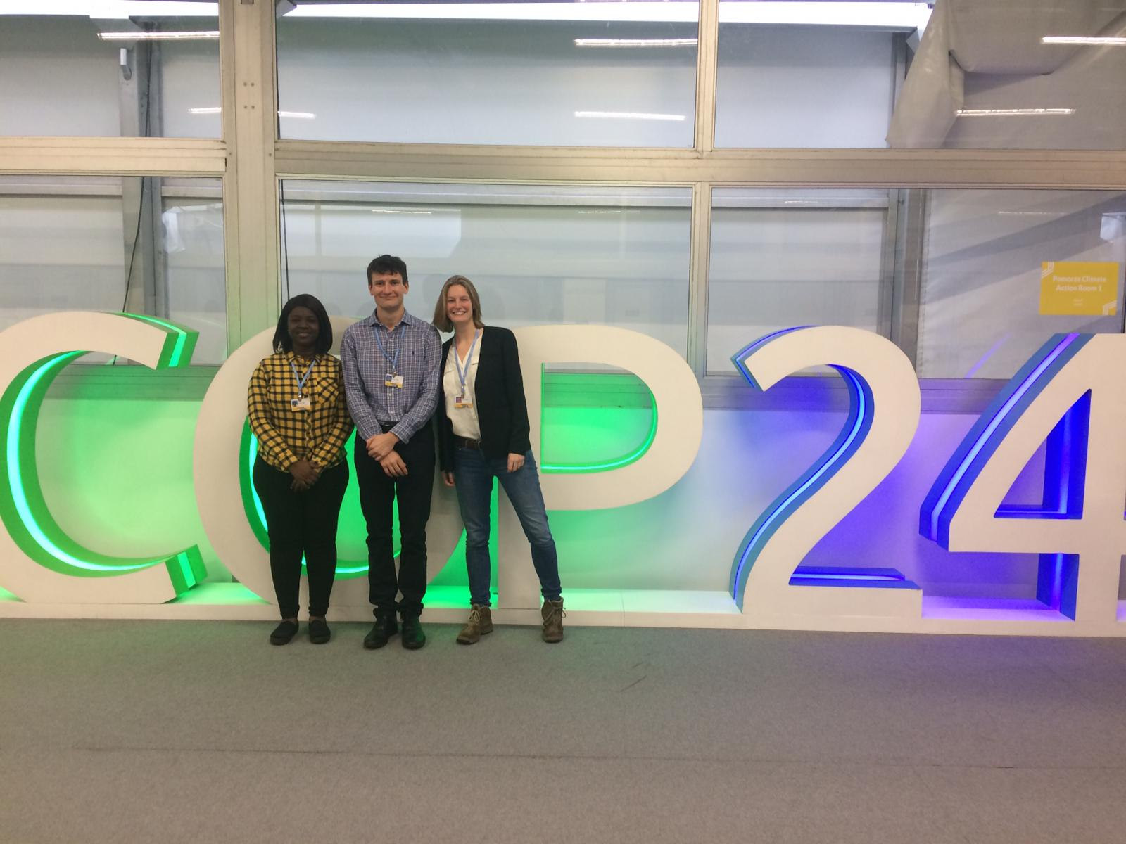 COP24 - some of the Grantham Scholars posing in front of the massive COP logo
