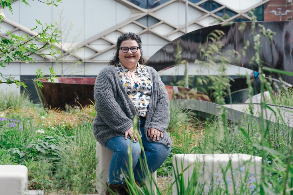 Roberta sitting outside the Grantham Centre where she studies GMOs and food sustainability