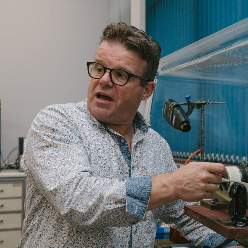 A close up on Tony Ryan at work in his lab