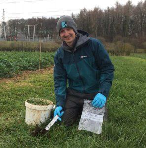 Joe in a field finding worm DNA in the soil