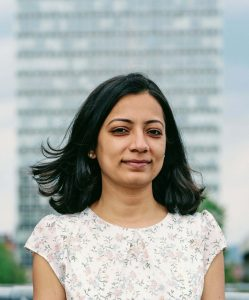 Reena standing in front of the Arts Tower in Sheffield