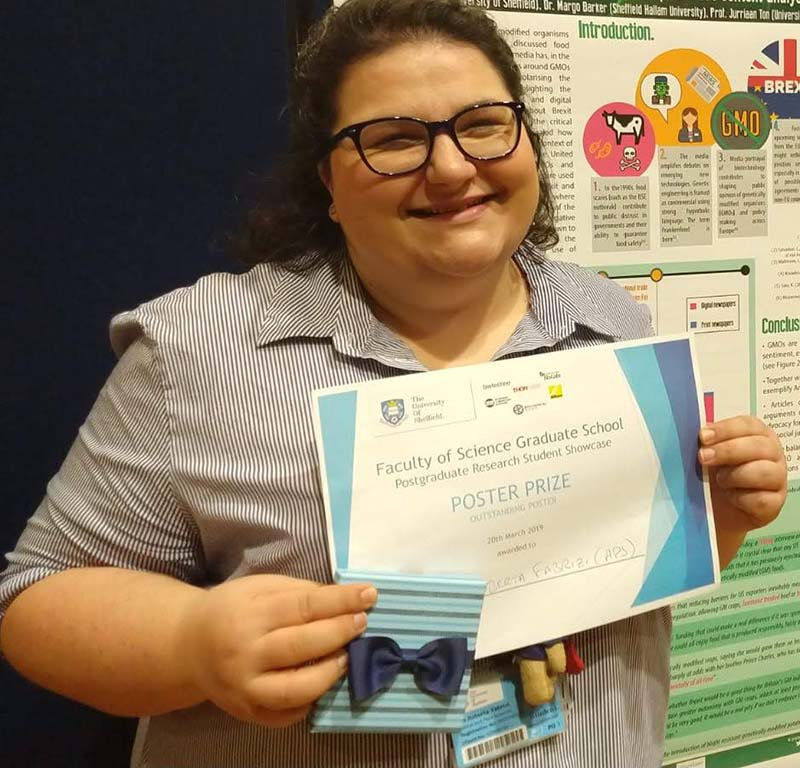Roberta winning a prize for her poster on GMOs and food sustainability