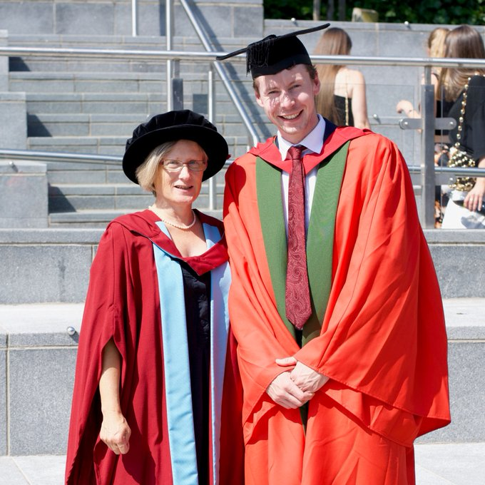 Graduation 2019 photo of a young man with the chancellor of the university