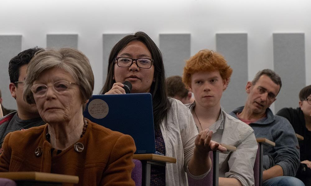 A young woman asks a question at the Festival of Debate