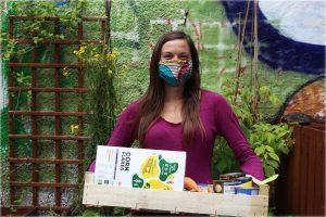 Nicole Kennard with mask and box of food