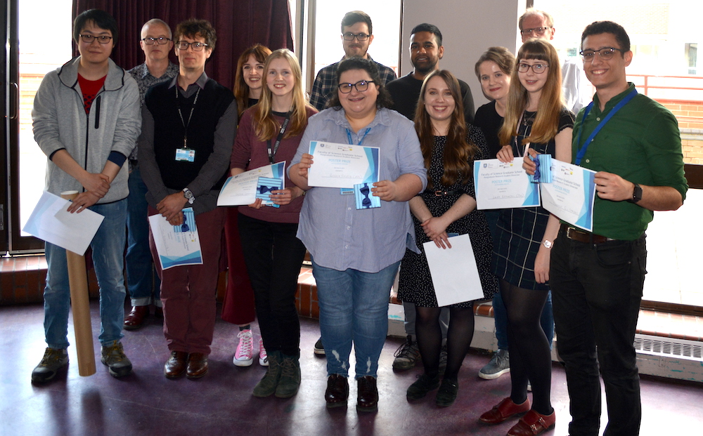 A group of students win their prizes for posters